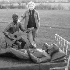 Reg with statues of Dylan meeting Woody Guthrie in Hospital - from Felix Dennis's garden of heroes